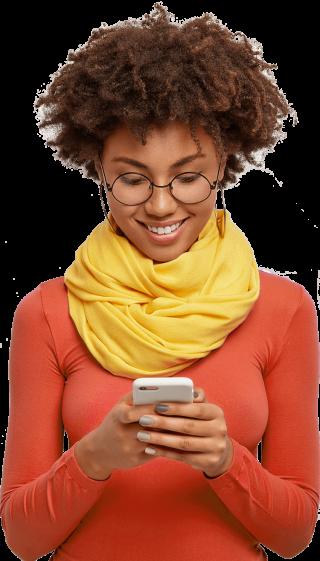 pleased-dark-skinned-female-holds-modern-mobile-phone-focused-into-display-wears-pink-turtleneck
